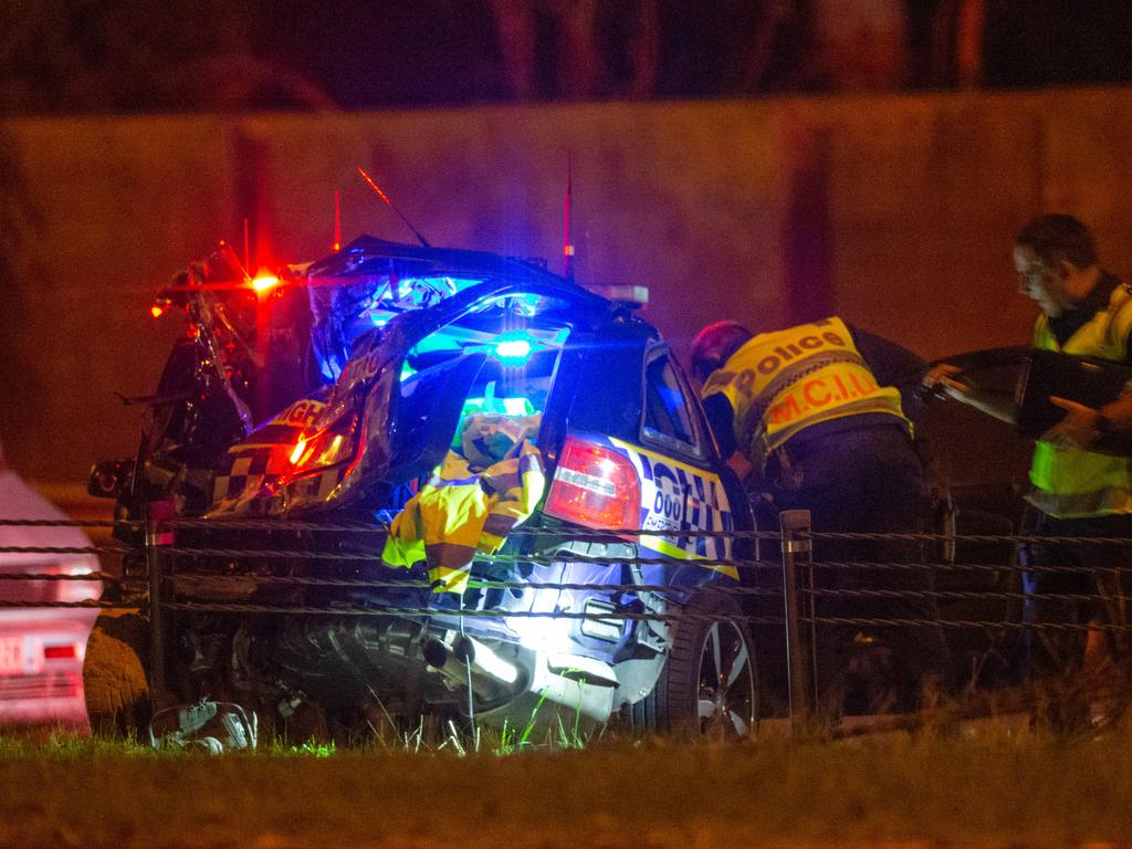 A severely damaged Victoria Police car at the scene.