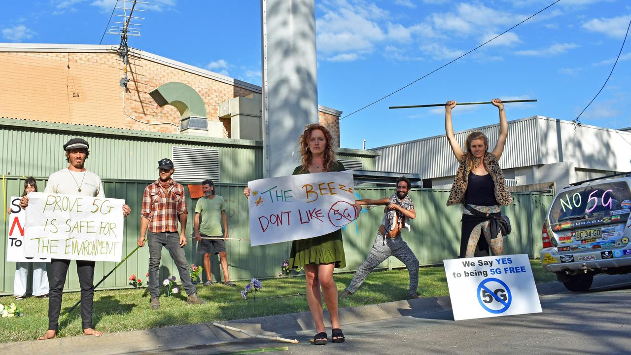 Anti 5G protesters, second from left Lex Richards, far right Ria Mithya, second right David Skywalker at the communications tower in Daley St in Mullumbimby.