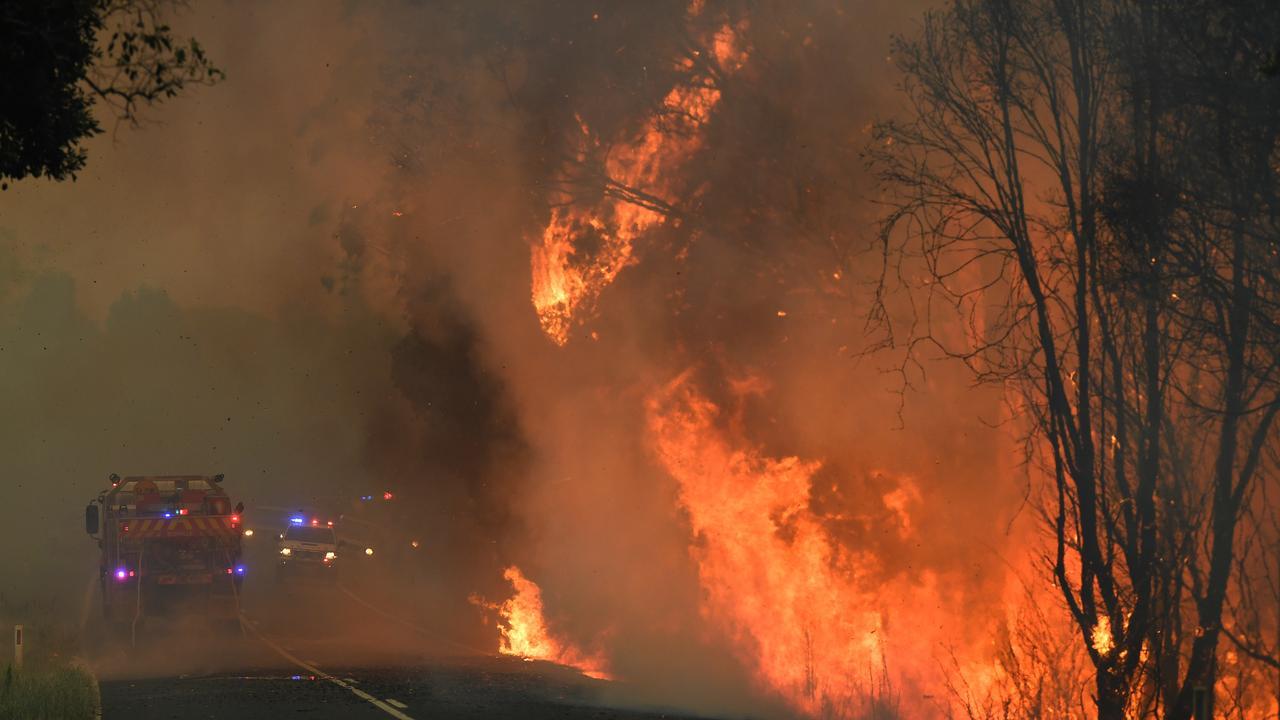 Fire crews tend to a bushfire in Nana Glen, on November 12, 2019. (AAP Image/Dan Peled)