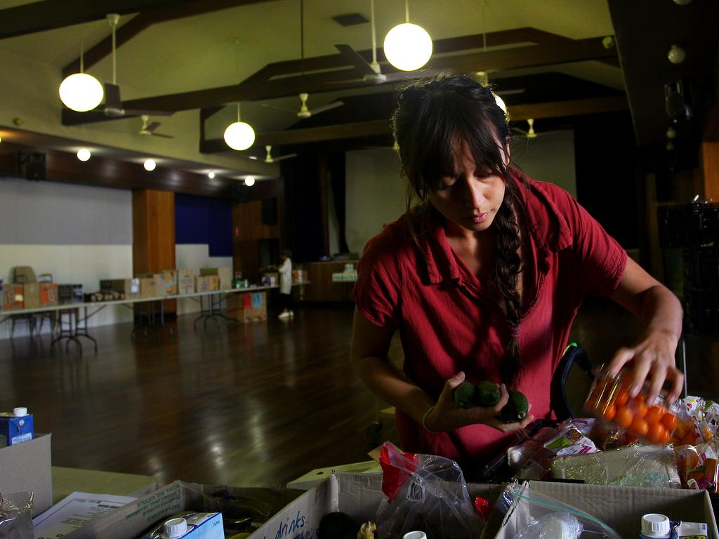 Clio Doughty, Family and Community Social Worker, prepares boxes of food essentials for those in need in Sydney, Australia. Picture: Lisa Maree Williams