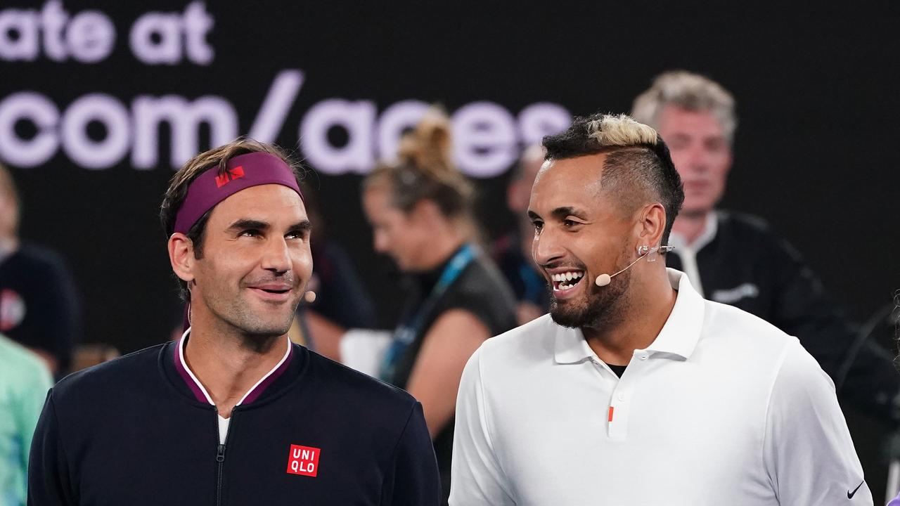 Roger Federer of Switzerland and Nick Kyrgios of Australia pose for a photo during the Rally For Relief at Rod Laver Arena in Melbourne, Wednesday, January 15, 2020. Tennis stars have come together for the Rally for Relief at Rod Laver Arena in Melbourne to raise money in aid of the bushfire relief efforts across Australia. (AAP Image/Scott Barbour) NO ARCHIVING