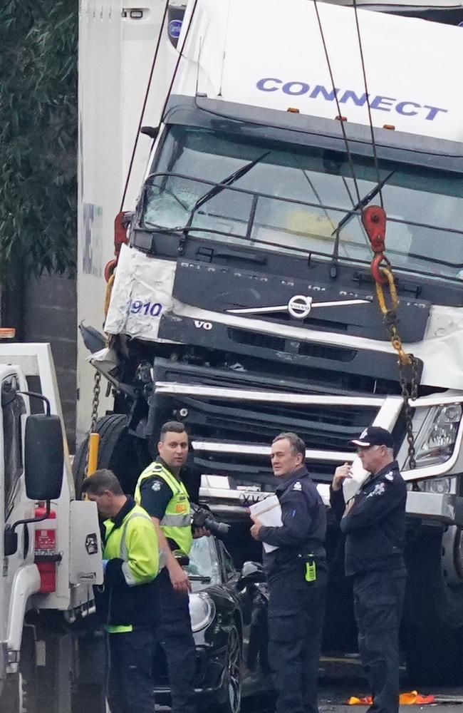 Police officers attend the aftermath of a collision near the Chandler Highway in the suburb of Kew in Melbourne. Picture: AAP Image/Scott Barbour