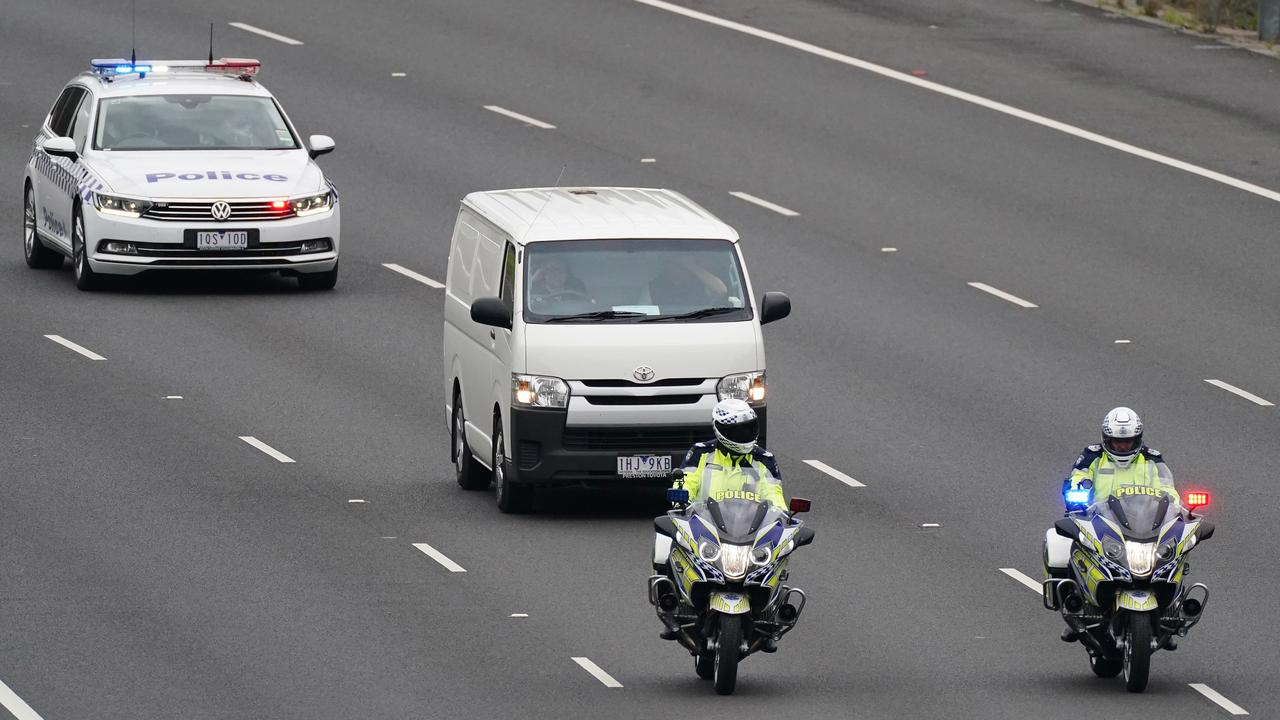 The bodies were taken away in a coroner's van. Picture: Scott Barbour/AAP