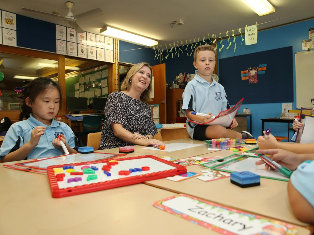 Year one students Mia Zhao, Lincoln Palermo and Joosung Byon with teacher Lisa Kent at North Rocks Public School in Sydney before social distancing was put in place. Picture: Britta Campio