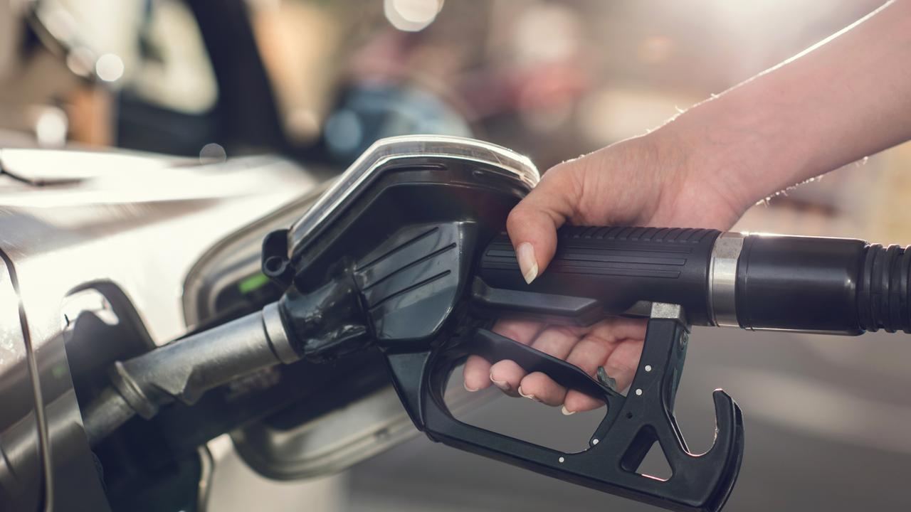 Unrecognizable person refueling gas into a gas tank.