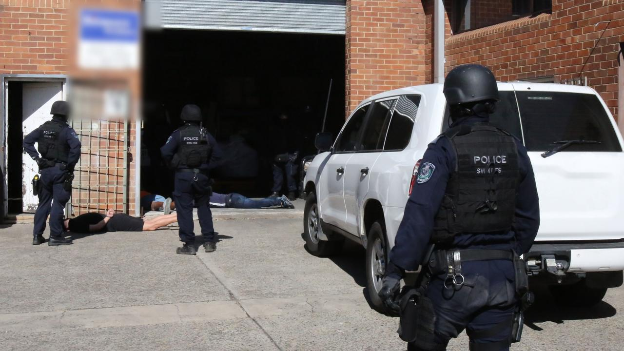 Police raided a business at Old Guildford just after 10.30am yesterday.
