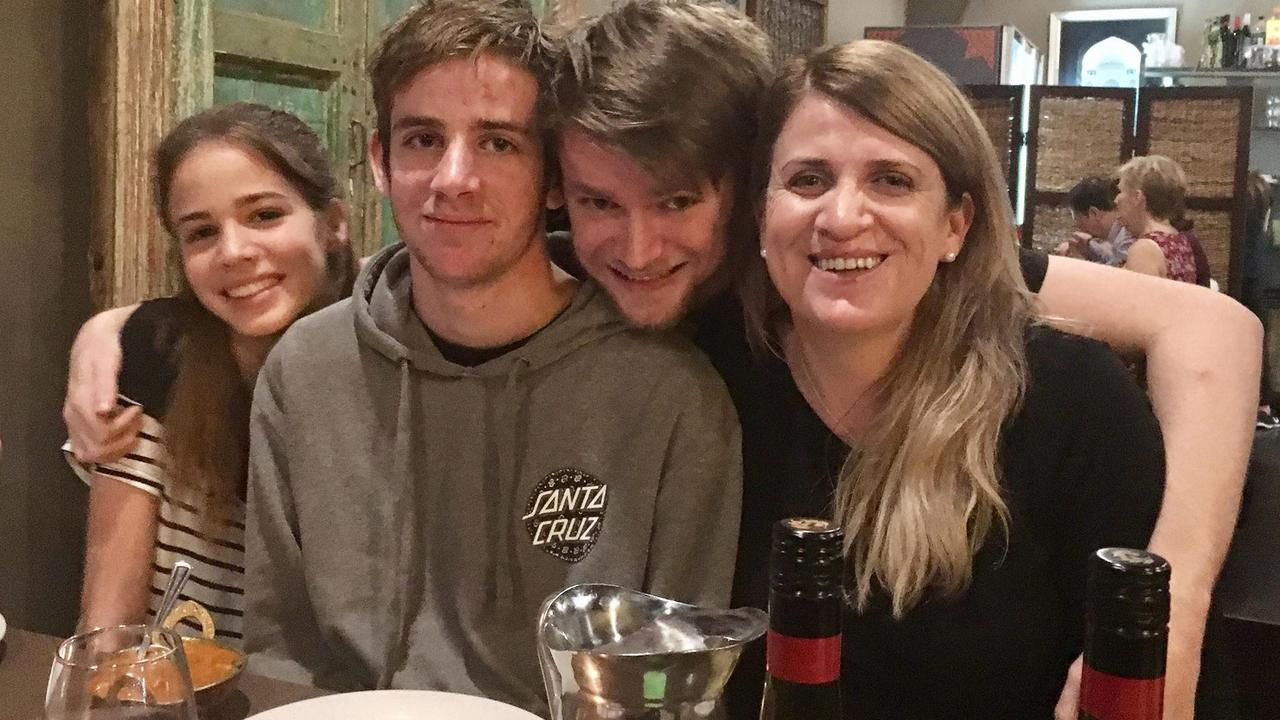 CLOSE FAMILY: Liam Wolf with his mother Susan Devine and siblings Izaak and Alanah.