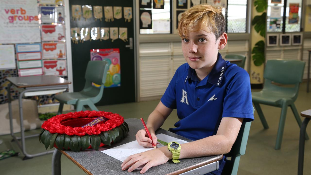Students from Redlynch State College have been writing letters to veterans for Anzac Day. Redlynch College year 6 student Jacob Cross, 11, with the letter he has written for local Navy veteran Ken Traill. PICTURE: STEWART McLEAN