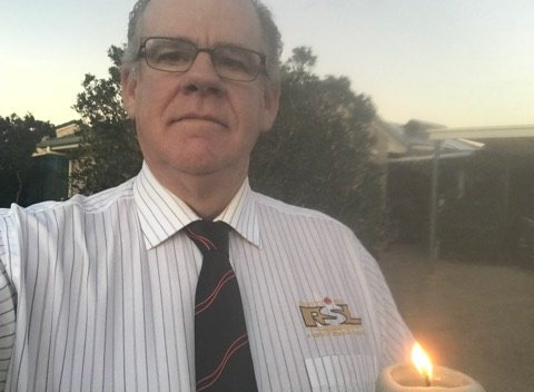 Robert Garland held a candle in his driveway to mark Anzac Day.