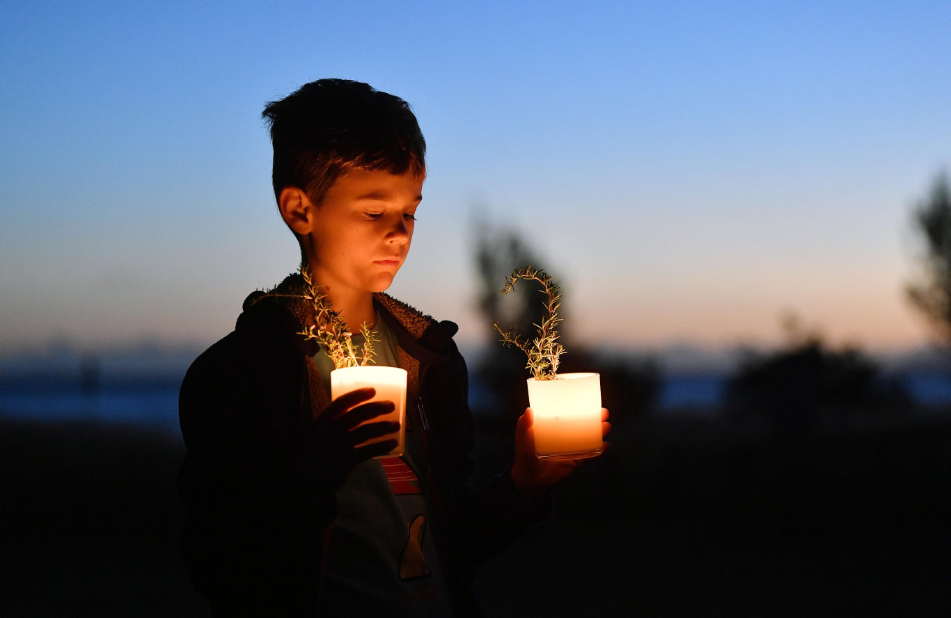 Jarvis Adams, 10, from Bucasia was up at dawn on his driveway to thank and reflect on those who have served our nation. Picture: Tony Martin