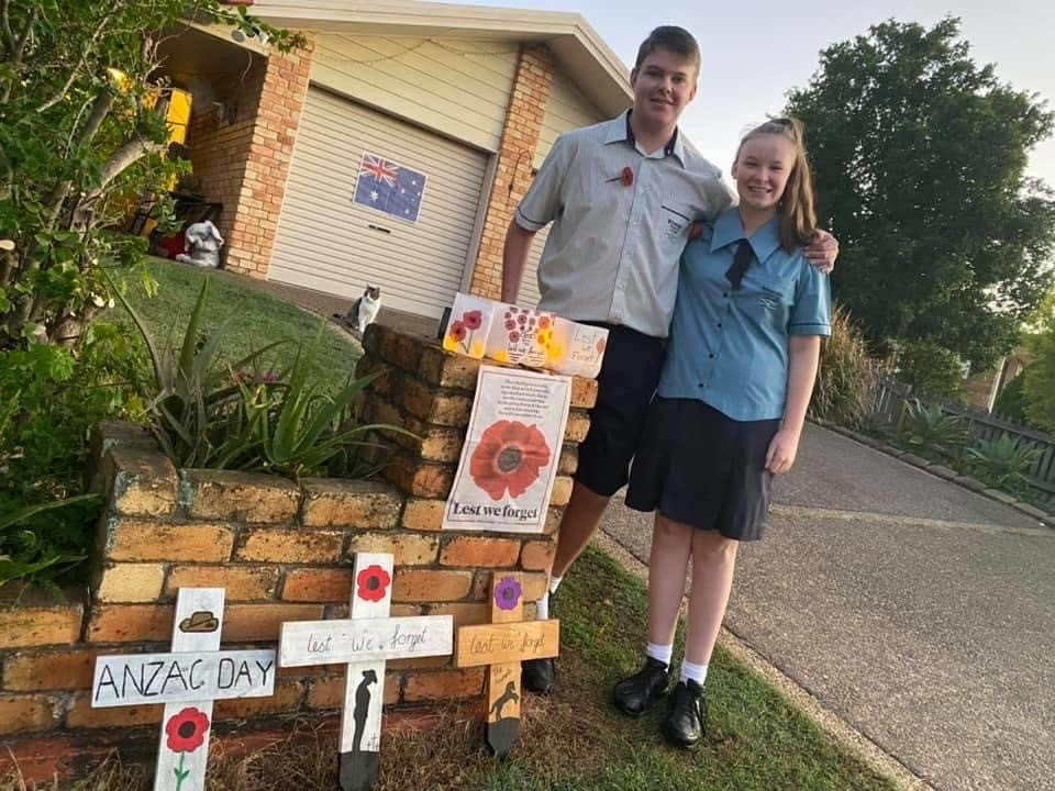 Oscar and Grace Pont with the wreath and crosses erected in their driveway on Anzac Day.