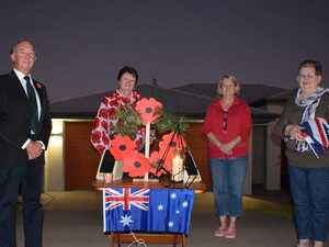 South Burnett residents light up the dawn for Anzac Day