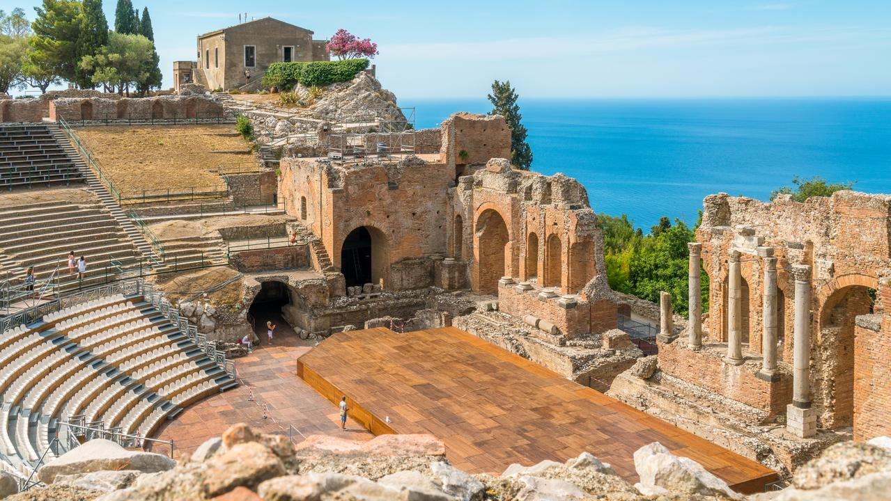 The island is even compensating some visitors' sightseeing to local attractions like these ancient ruin in Taormina. Picture: Supplied