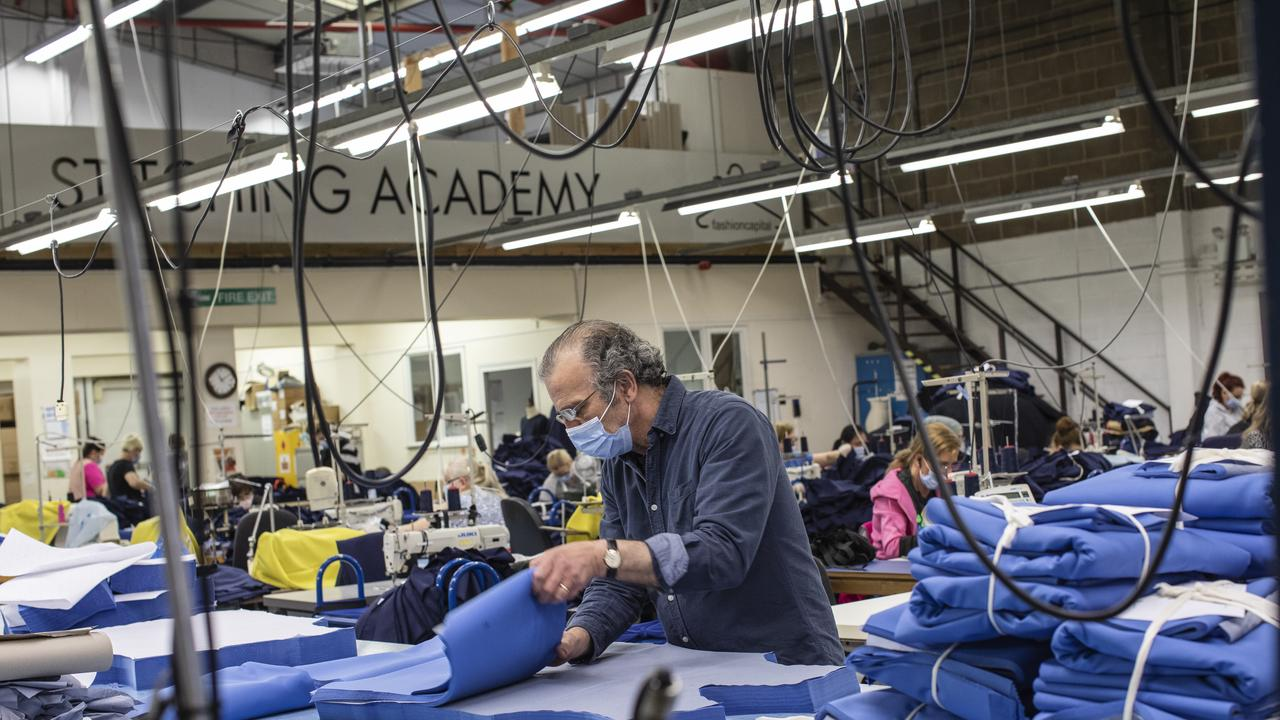 Employees at 'Fashion Enter' make scrubs for NHS staff on April 24, 2020 in London, England. Picture: Dan Kitwood/Getty Images