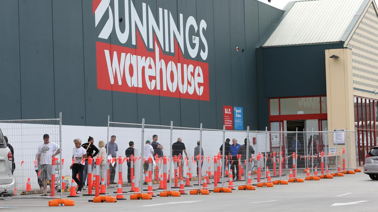 Shoppers in queue at a Bunnings Warehouse in Victoria after Stage 3 COVID-19 restrictions were put in place. Picture: Peter Ristevski