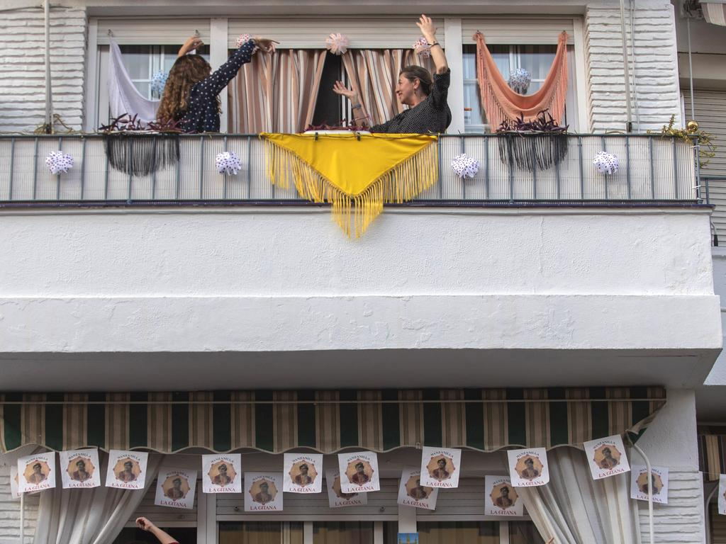 Without breaking the confinement rules and maintaining their distance from each other, Spanish residents are see on their balconies. Picture: AP