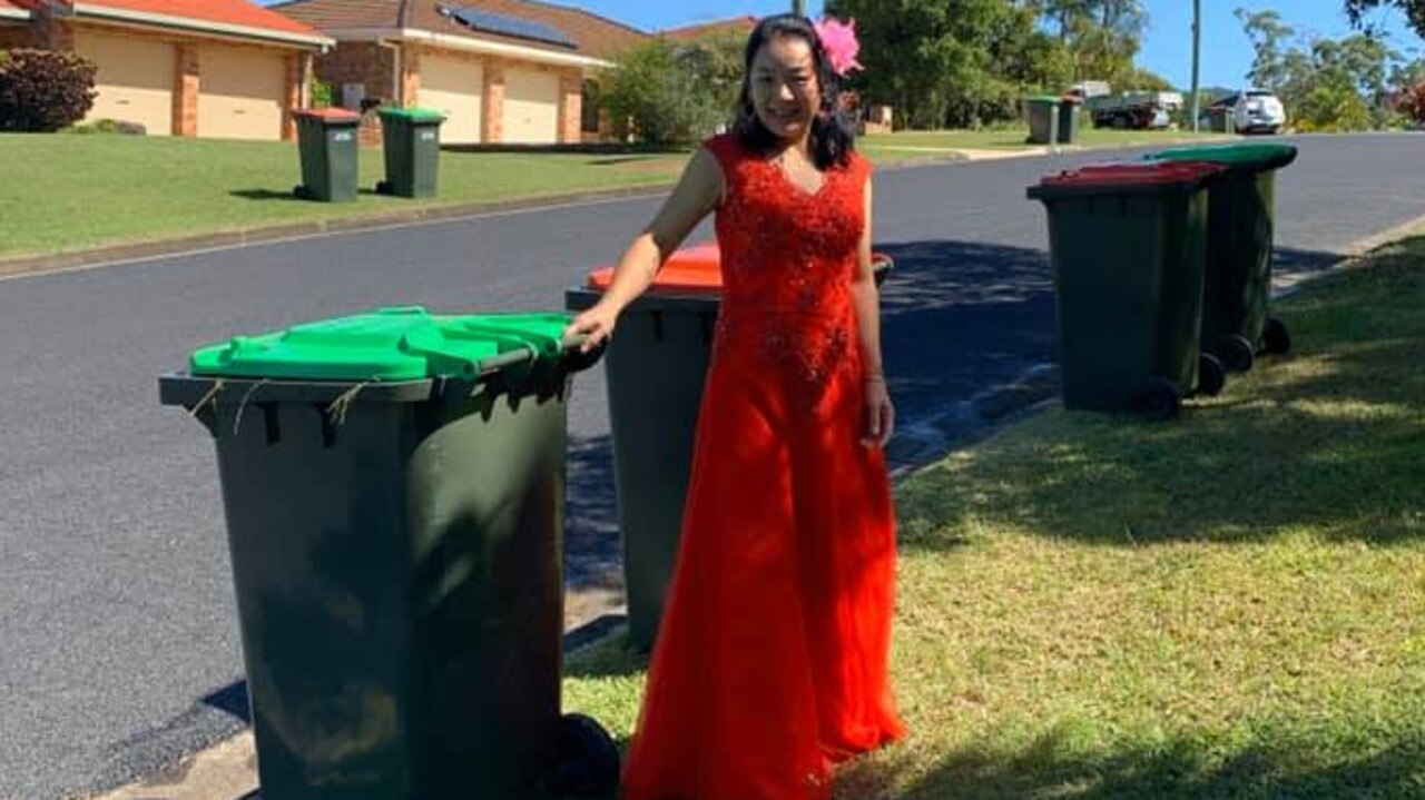 Vince's wife Ling pictured taking the bins out in her wedding dress in a post on the Bin Isolation Outing group.