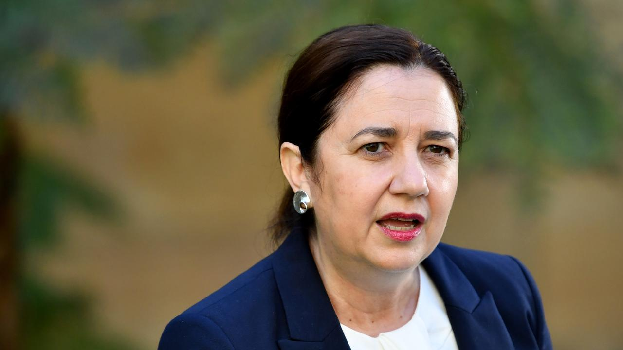 Premier Annastacia Palaszczuk said anyone who deliberately coughed, sneezed or spat on public officials and workers would face the fine. Photo: Darren England