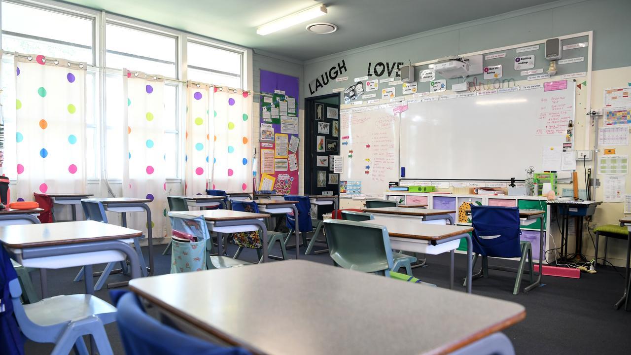 An empty classroom is seen at a primary school in Brisbane. (AAP Image/Dan Peled)