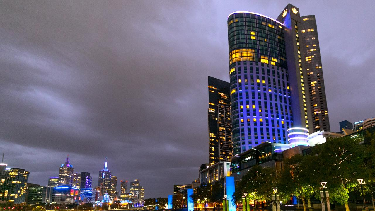 Crown Towers and Crown Riverwalk illuminated blue for the Victorian Police. Picture Fiona Hamilton