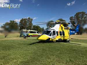 Injured man airlifted after being trapped under farm equipment