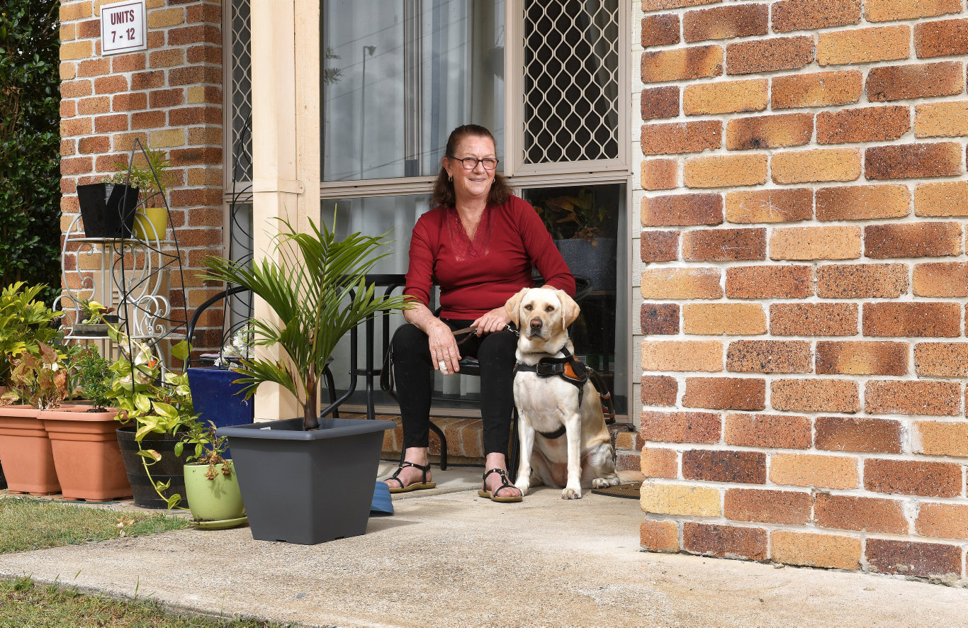 East Ipswich resident Heather Kidd with her guide dog Julia.
