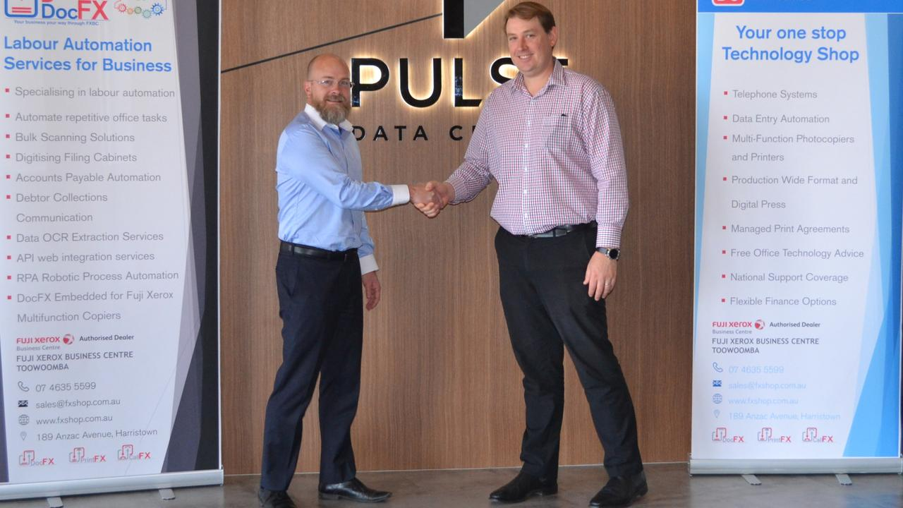 Fuji Xerox's Len Townsing (left) and Pulse Data Centre's John Henderson. (Picture taken before distancing rules.)