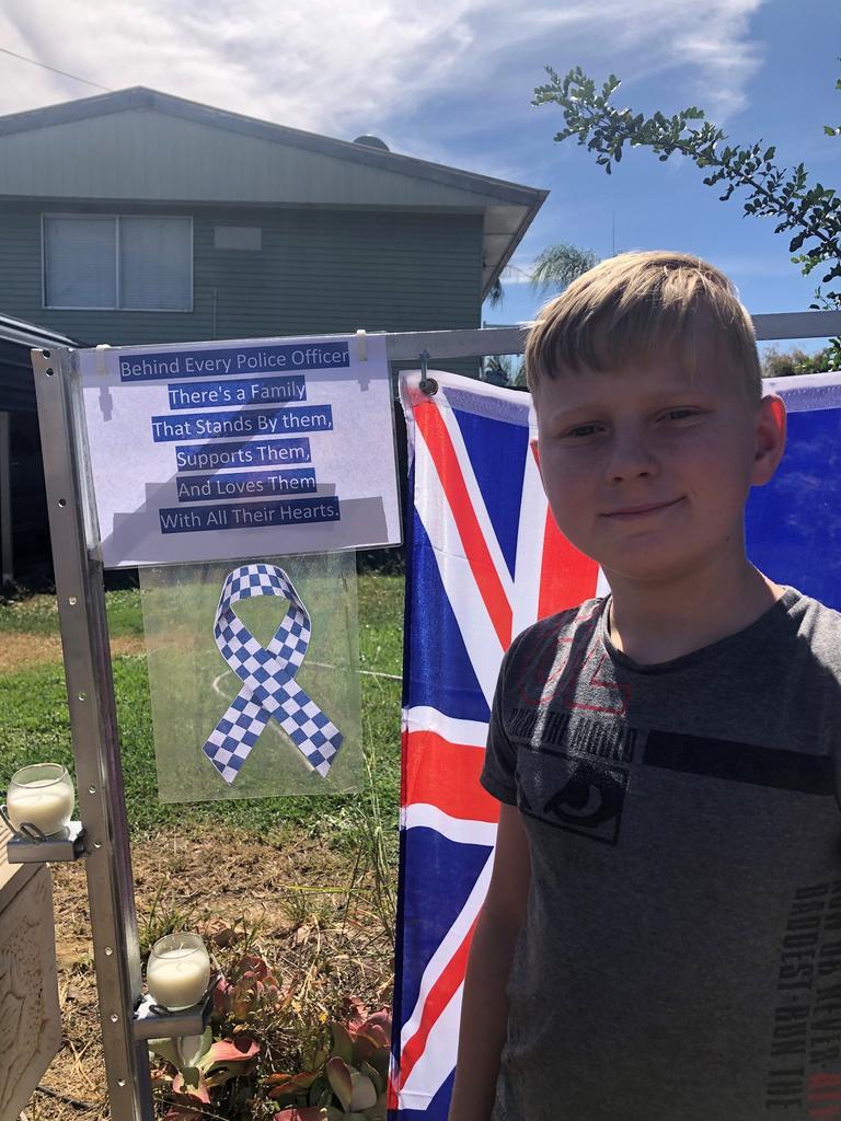 Jayden in front of his memorial.
