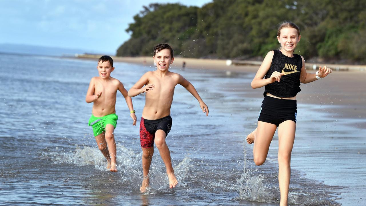After a day of home schooling, Blake, 7, Zac, 9, and Ellie, 11, Stewart get some exercise on Torquay Beach - however a cold change moving in later in the week could spell the end of beach weather.Photo: Alistair Brightman
