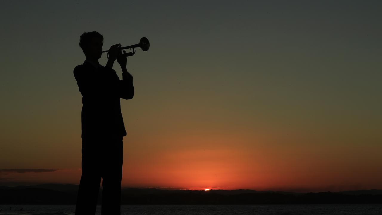 Lindisfarne year 10 student Monty Lush plays the Last Post as the sun sets over the Gold Coast on Anzac Day. Photo: Scott Powick.