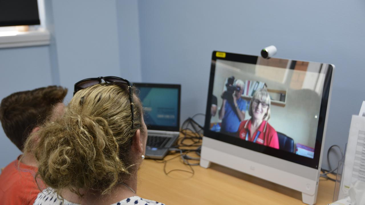 Walker Taylor (left) and mum Zenia Taylor-Kellock at a telehealth meeting with a specialist.