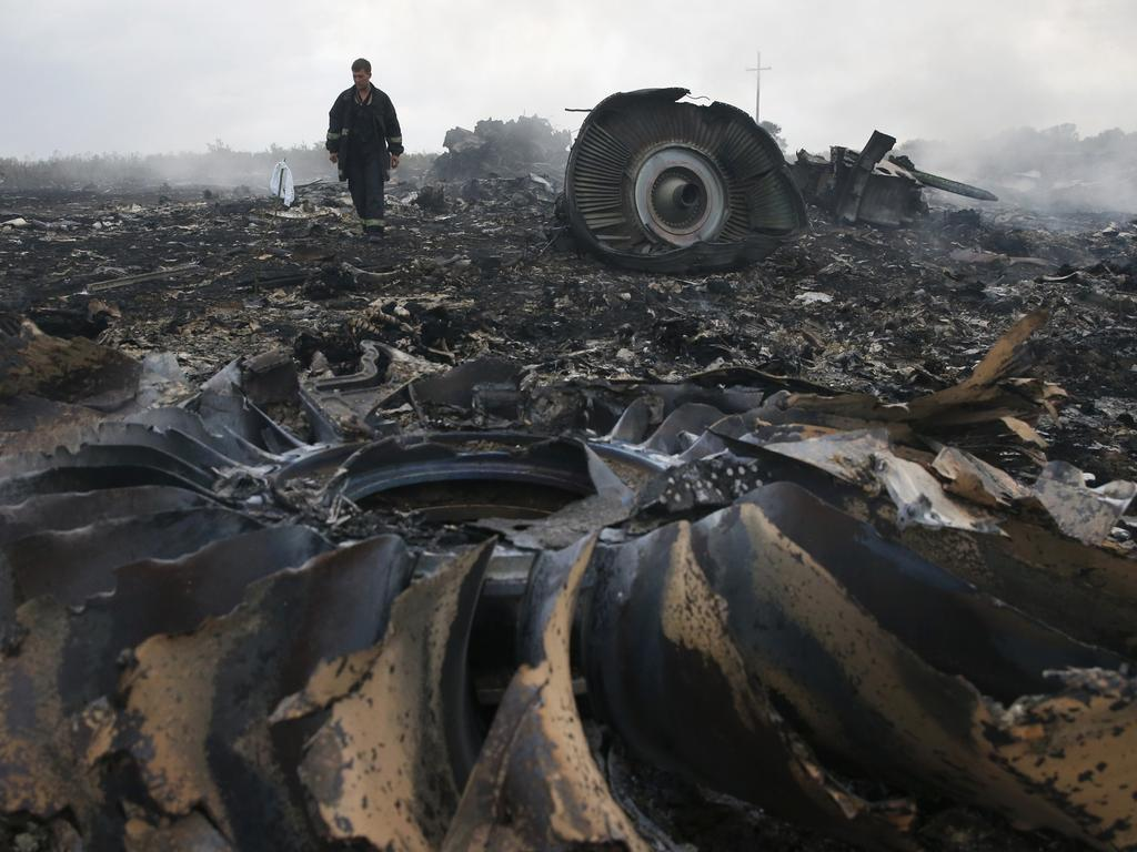 An Emergencies Ministry member walks at a site of a Malaysia Airlines Boeing 777 plane crash near the settlement of Grabovo in the Donetsk. Picture: Reuters