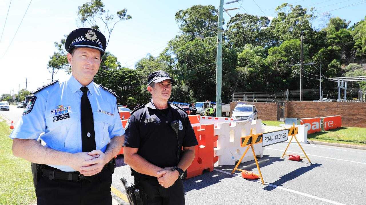 Gold Coast Police District Chief Superintendent Mark Wheeler and Senior Sergeant Brendan Murphy inspect barriers at Miles Street in Kirra. Photo: Scott Powick.