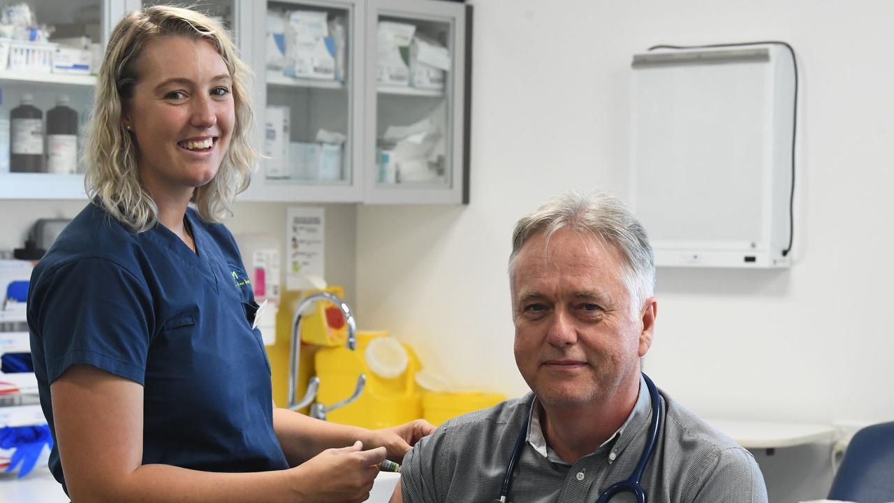 Nurse Rachel Matthews give Dr John Manton his flu shot at Excelsior Medical Centre