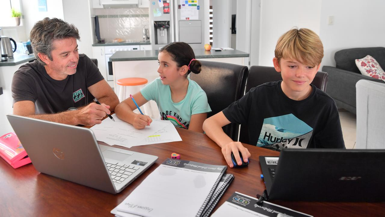 Glenn Weldon is homeschooling his two children, Teagan and Jayden Weldon. He's using the resources provided by Sunshine Coast business Express Print and Mail. Photo: John McCutcheon