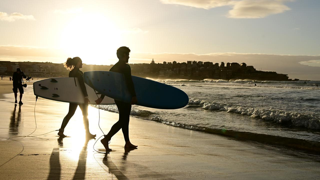 Surfers return to the water as Bondi Beach reopens to the public following an outbreak of coronavirus. Picture: AAP/Joel Carrett