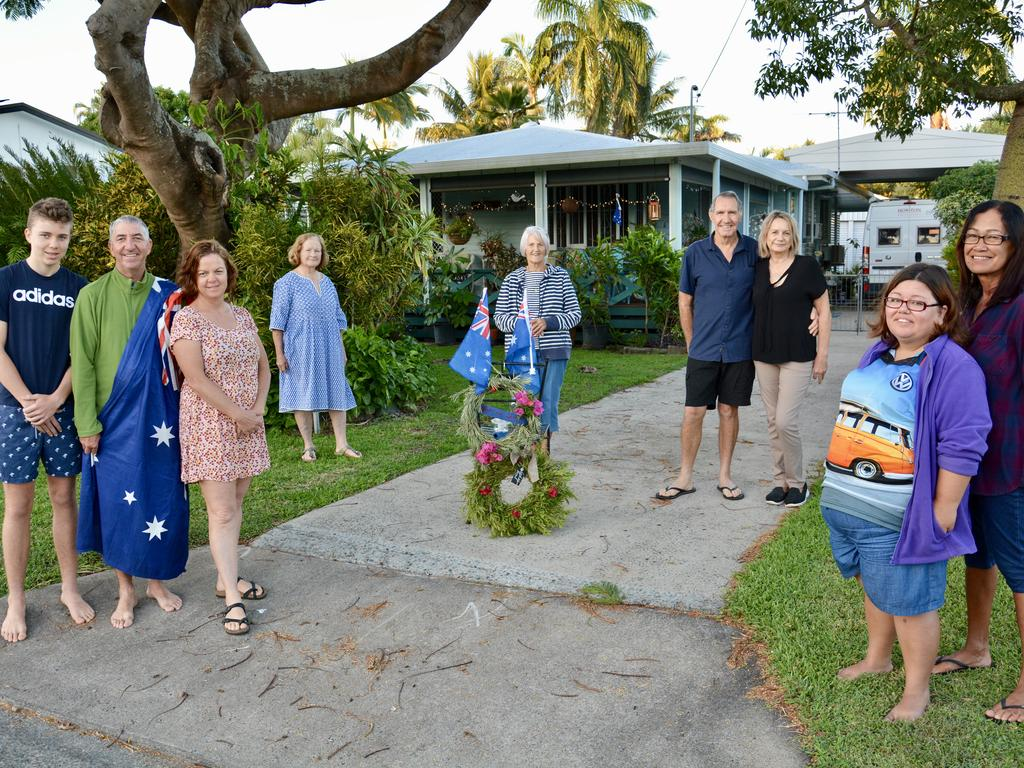 Neighbours in Shakespeare Street, Mackay commemorated Anzac Day 2020 with a Light up the Dawn in their driveways. Left to right: Baxter, 14, Gavin and Leanne Norsworthy; Patti Courtice; Kay Biggam; Paul and Fiona Mason; and Stacey and Debbie Paskins. Picture: Tony Martin.