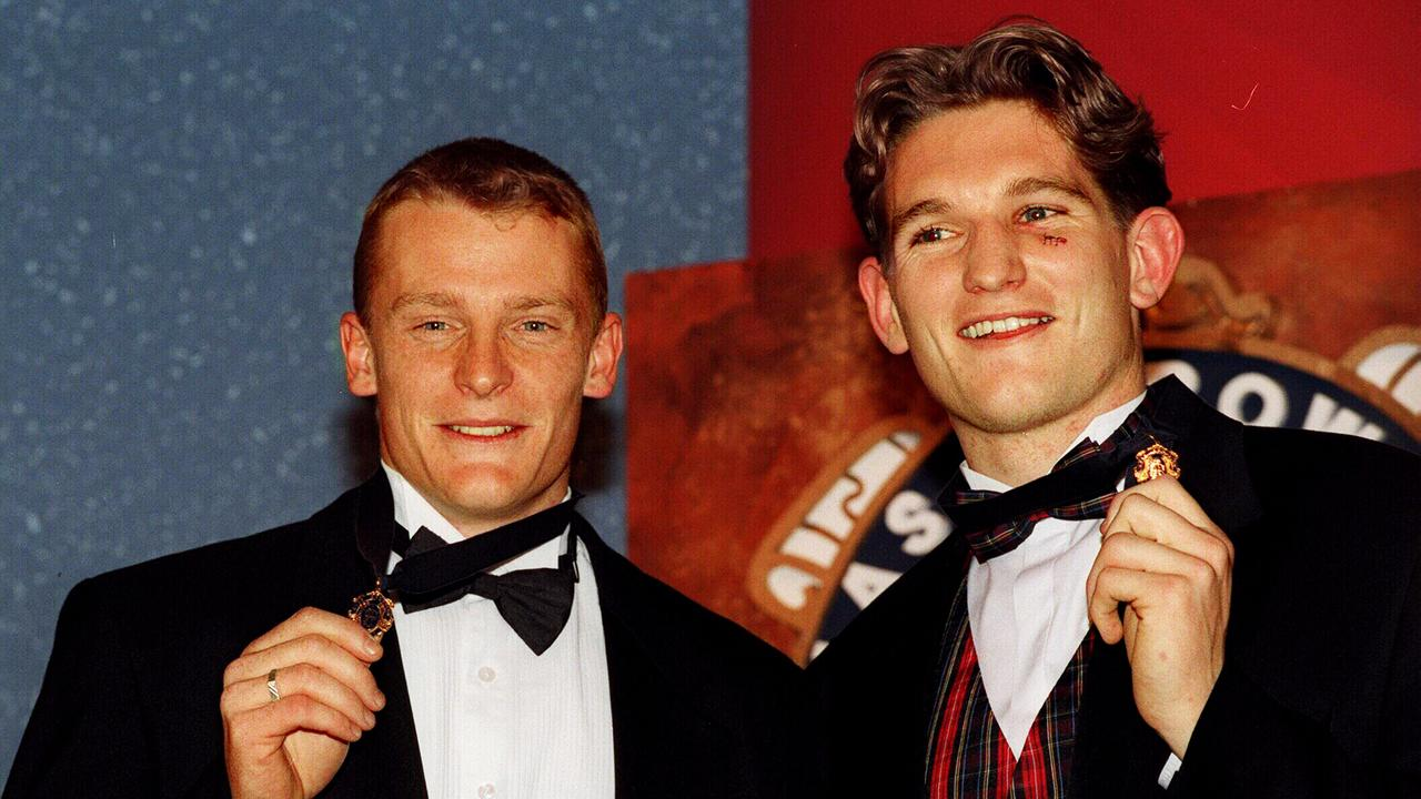 Michael Voss and James Hird after tying the 1996 Brownlow Medal. Picture: Andrew Tauber