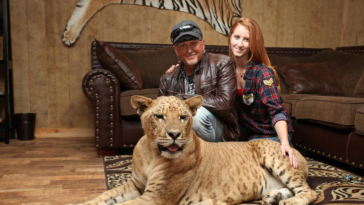 Jeff Lowe and Lauren Dropla with Faith the liliger at their home inside the Greater Wynnewood Exotic Animal Park. PHOTO: Ruaridh Connellan/BarcroftImages/Barcroft Media