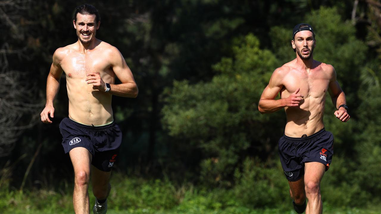 Phil Davis trains with teammate Matt Buntine during the AFL's shutdown. Picture: Toby Zerna
