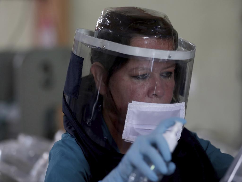 A workers wearing a protection mask against the new coronavirus in Bogota, Colombia. Picture: Fernando Vergara/AP