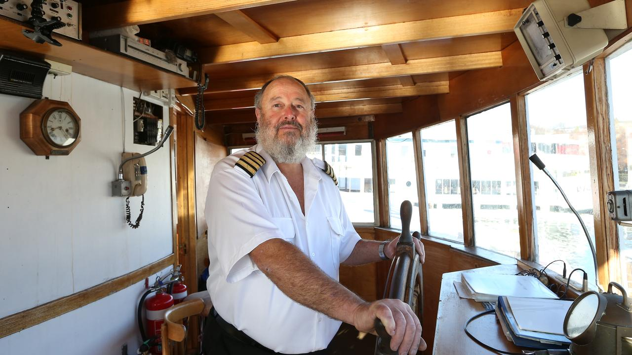Former Cartela skipper Michael Roche in 2014 taking the ship from the Brooke Street Pier in Hobart to Franklin.