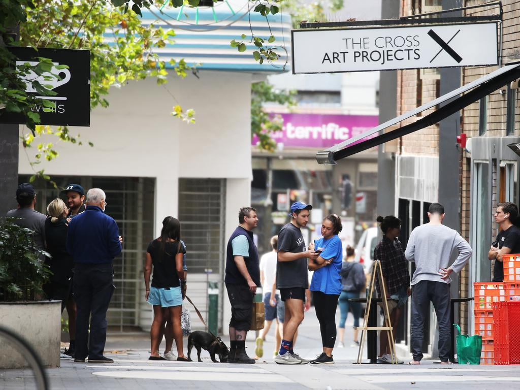 People line up for coffee on Easter Monday in Kings Cross, NSW during the COVID-19 shutdown. Picture: John Feder/The Australian.