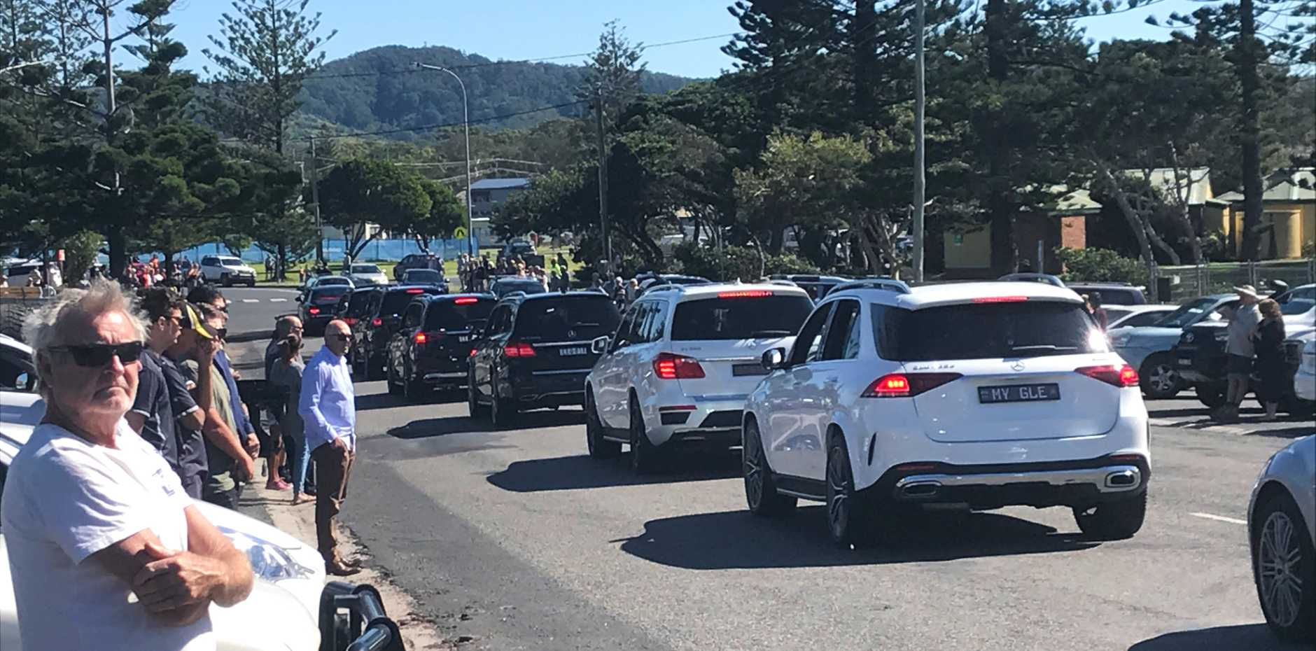 Due to Covid-19 restrictions on funerals, Woolgoolga residents have today lined the streets while social distancing to farewell Dr Amarjit Singh More.