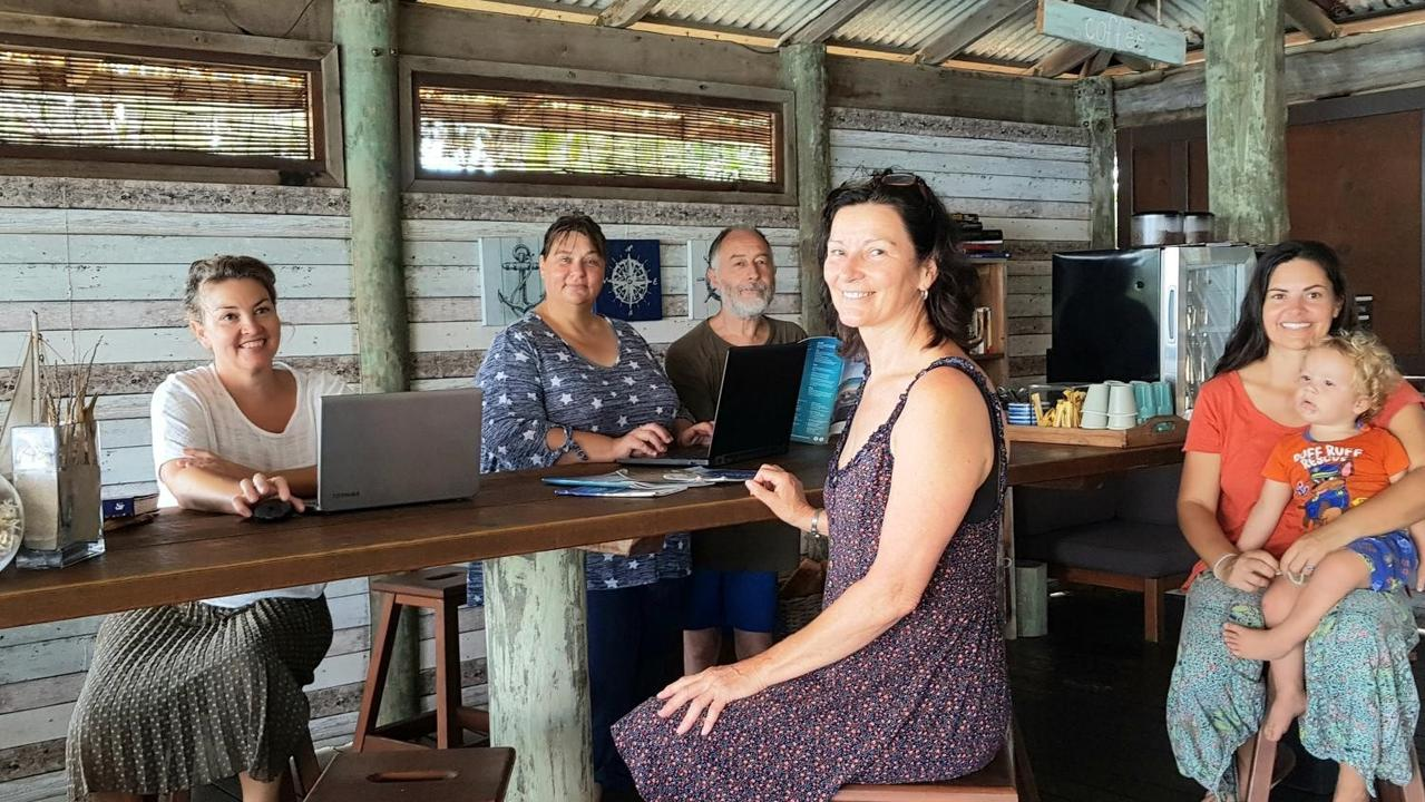 ISLAND HOME: Anita Lord, Christine Guy, Amanda and Phil Porter, Laureth Rumble and little Steel work together on marketing strategies.