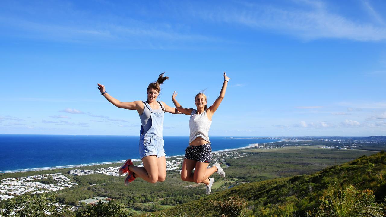 Jana Hartwich and Carola Heier soak up the sunshine on top of Mt Coolum. Photo: Lachie Millard