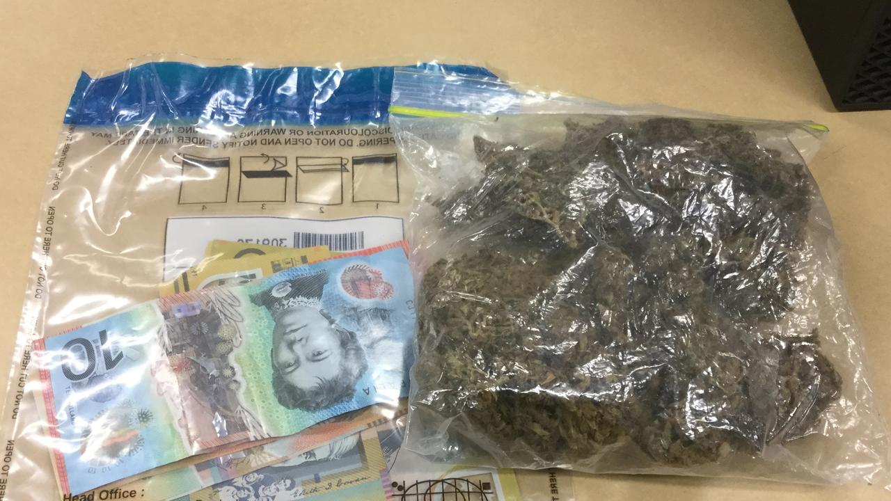 Cairns police arrested a French tourist on a city rooftop on Aplin St on April 29, 2020. A bag the man dropped earlier in the chase was found to contain cannabis and cash.