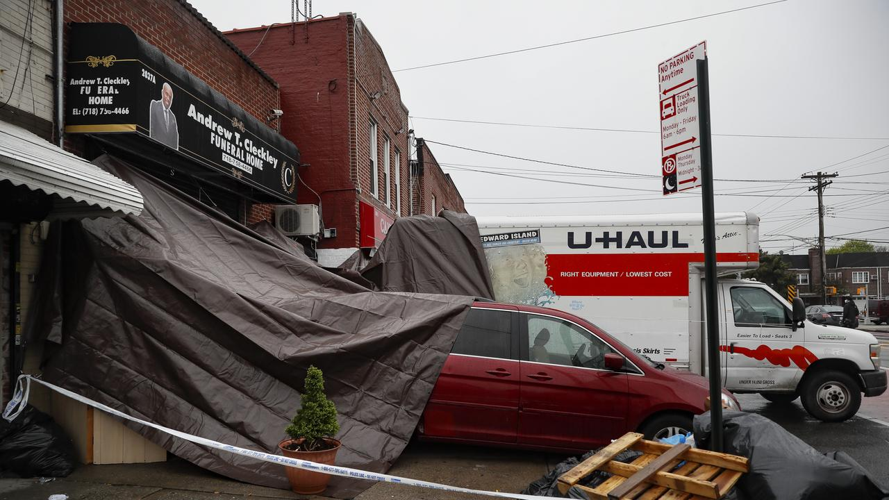 Police were called to the funeral home Wednesday after it resorted to storing dozens of bodies on ice in rented trucks. Picture: AP / John Minchillo.