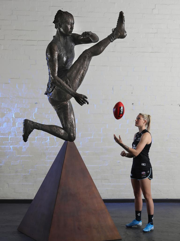 Tayla Harris with her life-size statue, commissioned by NAB. Picture: Alex Coppel.
