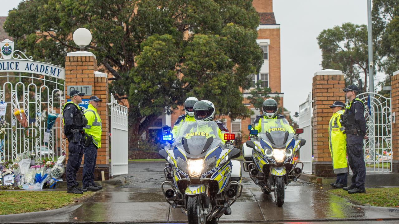 A police escort will accompany the police officer's body to the NSW border. Picture: Jason Edwards